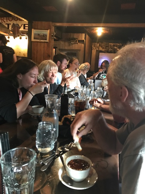 People eating dinner together at a restaurant in Butte.